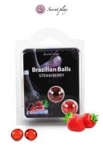 2 Brazilian Balls - fraise - La chaleur du corps transforme la brazilian ball en liquide glissant au parfum fraise, votre imagination s'en trouve exacerbée.